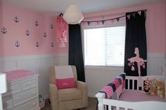 Baby Girl Nautical Nursery Ideas - love the anchor accent wall in this preppy pink and navy nursery!