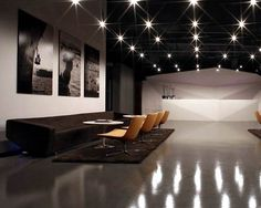 Lighting/ Concrete floor/ Shape of the reception table!