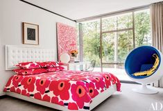 In Olivia's room, a Matisse print and a framed panel of vintage Stephen Sprouse fabric complement the Brad Dunning–designed headboard, clad in an Edelman leather; the bedding is by Marimekko, the spherical bedside lamp is by Flos, the ball chair is vintage Eero Aarnio, and the curtain fabric is by Fabricut | archdigest.com