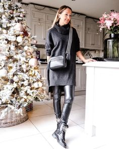 Sweater dress worn with leggings and boots | For more style inspiration visit 40plusstyle.com