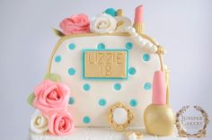 Here's a lovely and bright cosmetics bag cake with a vintage twist that we created! We were asked to design and make a polka dot make-up bag cake fit for an 18th birthday with a slight vintage feel, a tassel and a fresh colour palette. We were, other