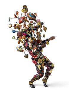 Nick Cave - Soundsuit, 2008    Appliqued found knitted and crocheted fabric, metal armature, painted metal and wood toys.