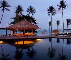 "Akaryn Samui, Koh Samui, Thailand.  ""There's a gentle elegance to Akaryn Samui's villas. Four-poster beds with 400-thread-count linens rest beneath whirring vintage-style fans. Sea breezes drift off of Hanuman Bay to your private garden and plunge pool. If you can rouse yourself from your outdoor daybed, there are sunrise and sunset yoga classes, a holistic spa, a boutique, and a tea salon."""