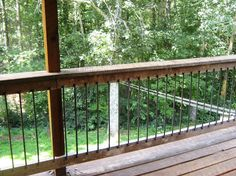 The balusters are cut rebar. This was a very cost effective solution for us. We also like the look against the rough wood of the balcony and log house. We intend to let them patina naturally. Rebar Railing, Balcony Railing Planters, Deck Cost, Cabin Porches, House Paint Color Combination, Exterior Stairs, Stair Lighting, Exterior Paint Colors For House, Cottage In The Woods