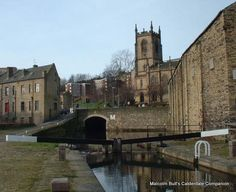 This view of the tunnel where the Rochdale Canal flows beneath Tuel Lane also shows Christ Church, Sowerby Bridge