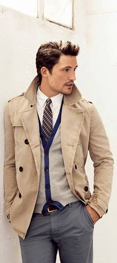 trench coat, white shirt, pattern tie, tan sweater vest, gray pant