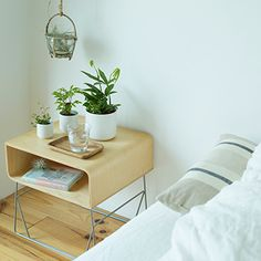 muji like the light frame of bedside unit achieving a sense of space for renters when not able to mount the unit on the wall
