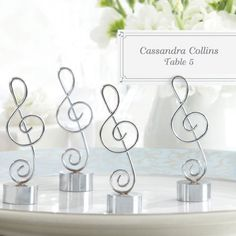 If doing pre-assigned seating...Music Note Place Card/Photo Holder by Beau-coup