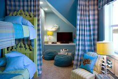 Green Home 2008 in Hilton Head, S.C.  Full of coastal colors and whimsical sea creatures, the kids' beachy bunk room cleverly makes maximum use of limited space by creating designated zones. A small corner under the eaves is an entertainment are