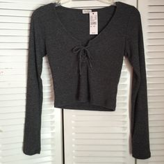 Brandy Melville Lace Up Elie Top Brand new with tags attached, one size Brandy Melville Tops Blouses