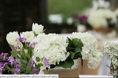 assorted jars and cans for reception centerpieces