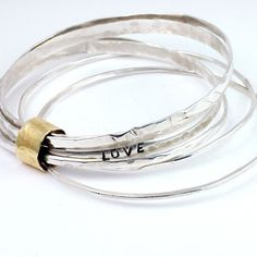 Silver bangles wrapped in gold, with the word LOVE ~ The Bead Girl on Etsy