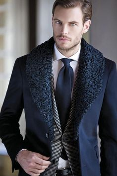 Blue wool coat with fur collar, white wide spread collar, blue necktie, black and white #houndstooth jacket.