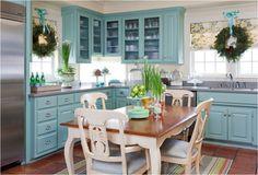 Turquoise kitchen, terra cotta floor, striped rug, concrete countertop.