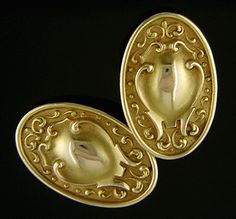 Elegant gold cufflinks in the late-Victorian Beaux Arts style.  Golden flowing scrolls and curves surround raised polished centers (please excuse the dark reflections from my camera).  Crafted in 14kt gold,  circa 1900.