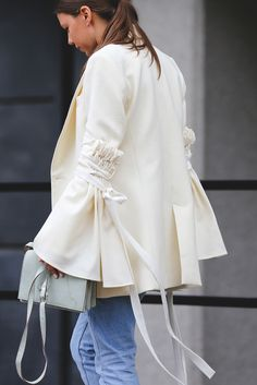 When you've got sleeves that make this big of a statement, keep the rest of the look low-key (i.e. just wear jeans).Topshop pants, Ellery jacket, Ganni bag. #refinery29 http://www.refinery29.com/2016/09/123831/lfw-spring-2017-best-street-style-outfits#slide-18