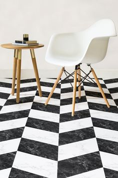 Savoy is a Black and White Marble Effect Flooring that brings you a timeless Herringbone pattern featuring an intricate black and white Marble design.