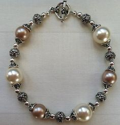 Antiqued Pearl and Silver Bracelet http://www.etsy.com/listing/93860090/antiqued-pearl-and-silver-bracelet