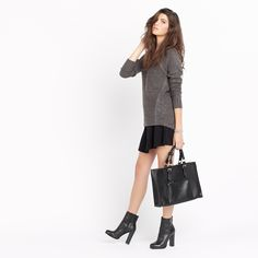 Live it up in this textured fluted mini skirt and cozy grey sweater!