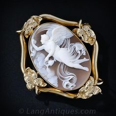 An angelic presence is captured in mid-flight in this enchanting & ethereal antique shell cameo elegantly presented in a graceful golden frame!