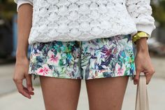 Tropical short shorts + White crew neck sweater + Some neon