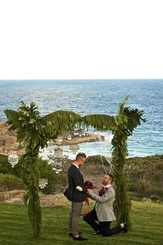 Elegant gay beach wedding, Green and crystal arbour with chandelier, bouquet red roses. Bridal Table, Wedding Altars, Arbour, Romantic Photos, Flower Bouquet Wedding, Wedding Photoshoot, Western Australia, Wedding Couples, Flower Crown
