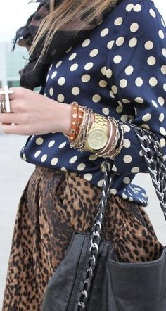 adore the juxtaposition of white blue polka dot blouse, stacked bracelets and watch, with the unusual plaid skirt