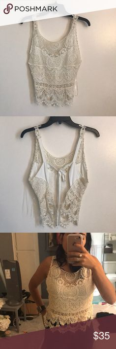 White Lace backless crop top White lace front backless top. A little loose on me since it's a size Large but can tighten. Has small stains as you can see in one of the pics, bleach would probably get it out, not noticeable. Reasonable offers welcome! Tops Crop Tops