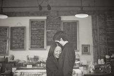 <3 the shop menu boards in the background | Engagement session by http://theapartmentphotography.com