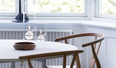 Wolfard Oil Lamps, CH24 (Wishbone or Y chair) by Hans Wegner in walnut, PK54 dining table by Poul Kjærholm with white marble from Greenland