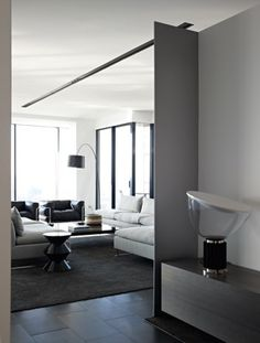 HASSEL, Australian based architectural interiors firm, black and white living room