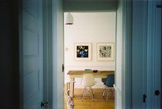 wall art + farmhouse table + eames chairs
