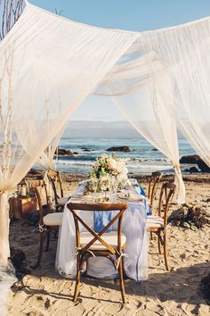 beach wedding reception - photo by Michelle Roller Photography…