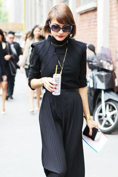 structure black top and black pleated maxi skirt in an all black ensemble