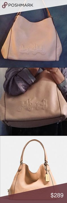 NWT🌷Coach Eddie Shoulder bag in blush Gorgeous soft grain leather shoulder bag. EMBOSSED HORSE AND CARRIAGE EDIE SHOULDER BAG IN PEBBLE LEATHER Amazing soft blush nude color that will be a perfect match for the season. 100% Authentic with tag and dust bag. I have a beautiful Coach gift box that I can add to it. (Stock in0137135) Details Pebble leather  Inside zip, cell phone and multifunction pockets  Zip closure, fabric lining  Handles with 10 1/2 drop  13 3/4 (L) x 11 (H) x 6 1/4 (W)…