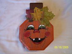 Pumpkins painted on paver stone. By Linda Hallett