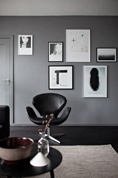 black and white wall art by Sarah Widman. Love the grey wall and door painted in the same colour.