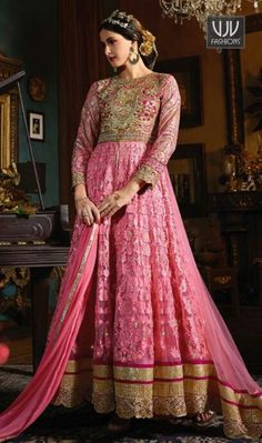 Distinguishable Pink Color Silk Net Anarkali Designer Suit Make the heads turn as soon as you dress up with this beautiful pink color banglori silk and net anarkali designer salwar suit. The embroidered and lace work appears chic and best for casual and party.