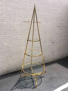 Sculptural Brass Pyramid Etagere Display Shelf | From a unique collection of antique and modern shelves at https://www.1stdibs.com/furniture/storage-case-pieces/shelves/