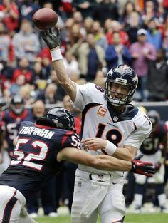 Peyton Manning First NFL Game | Denver Broncos' Peyton Manning (18) is pressured by Houston Texans Tarpinian 12-22-13