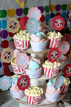 Cotton Candy and Popcorn Cupcakes--I think I might just fill cupcake wrappers with specialty popcorn and cotton candy instead of baking...