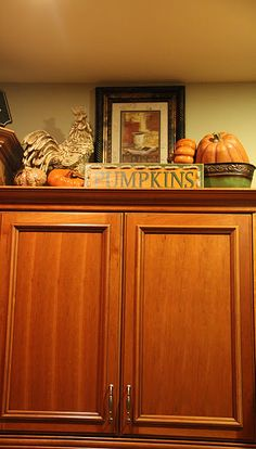 fun way to decorate above kitchen cabinets for fall