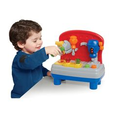 """Little handymen in training will love the realistic sound and action of this Mini Work Bench from Bruin, a Toys 'R' Us exclusive. Constructed from molded plastic that is both colorful and durable, it promises your child lots of time spent in simulated construction projects. Every part of this bench is interactive with lights and realistic sounds. It even plays """"Knick-Knack Paddy Whack!"""" This bench features a rotary arm saw, a drill press, a screwdriver, and a hammer. Dimensi..."""