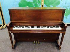 "Free Everett piano. 58.5"" wide 45.5"" high 24.5"" deep"