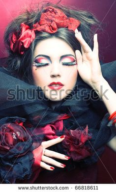 stock photo : Queen of hearts. Creative lady in black and red colors and with bright make-up.