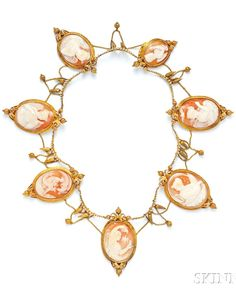 A Victorian Gold and Shell Cameo Necklace, 1860. The seven cameos depicting classical figures, possibly representing themes of night, sleep, and death, including various goddesses and their attributes, probably Venus with doves, Juno with owl, Nyx with bat, and Ceres with swine and thunderbolts of Jupiter, and the infant Mercury with poppy head motifs, all in elaborately engraved bezels joined by swags of chain and seed pearls, engraved drops, cameo of Hebe and the Eagle of Jupiter later.