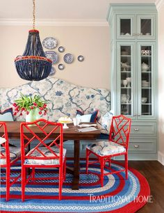 This cheerful home in Arkansas is designed by Tobi Fairley for a couple with five children. Using bold, vibrant colors and traditional de...
