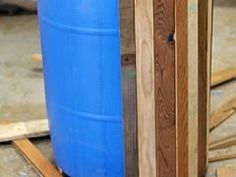 and Low Cost 55 Gallon Drum Planters Reclaimed wood transforms a blue barrel (or ugly plastic pot) into a beautiful planter or patio storage.Reclaimed wood transforms a blue barrel (or ugly plastic pot) into a beautiful planter or patio storage. Outdoor Projects, Pallet Projects, Garden Projects, Woodworking Projects, Diy Projects, Woodworking Beginner, Diy Pallet, Woodworking Ideas Table, Pallet Beds