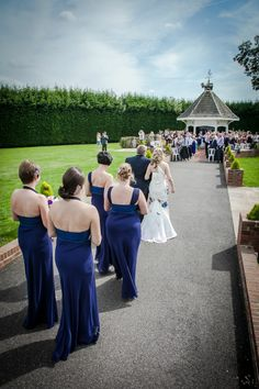 The bridal party walks up the aisle...