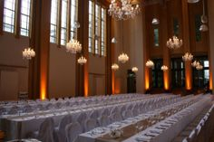 Awesome lighting. Love the long dinner setting and chandeliers